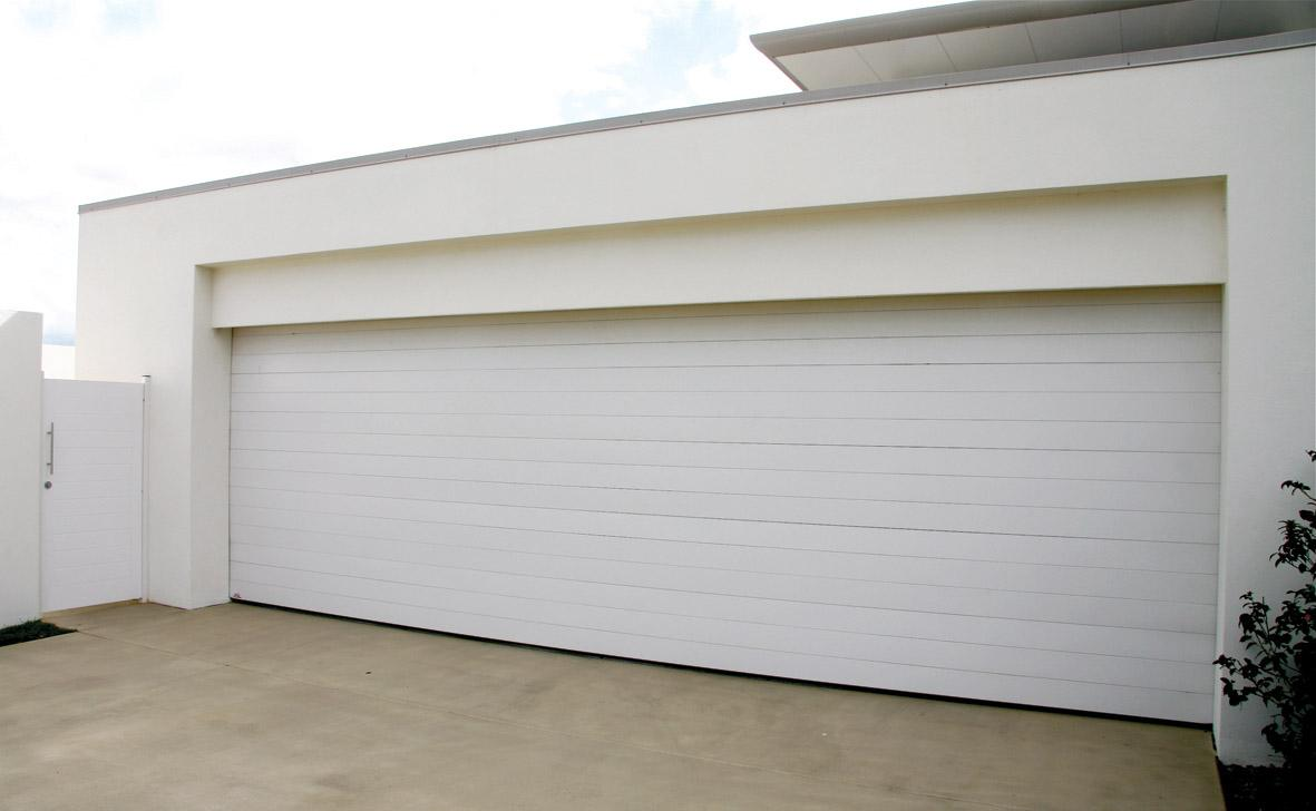 Click image for enlargement. Panel type  or sectional type  Garage Doors by Pirie Enterprises